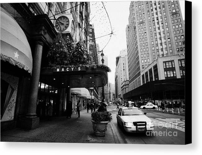 Usa Canvas Print featuring the photograph yellow taxi cab waits outside entrance to Macys department store on Broadway and 34th street by Joe Fox