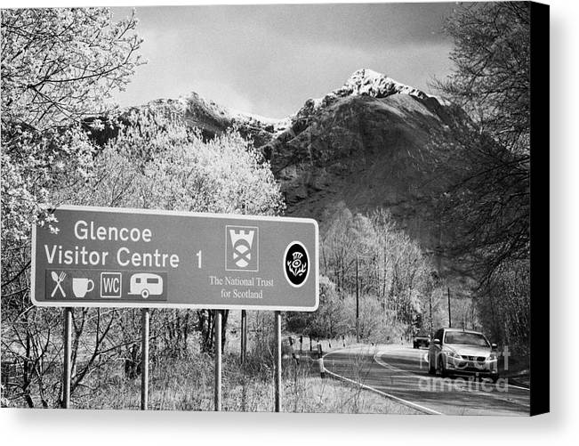 Tourist Canvas Print featuring the photograph tourist sign for glencoe visitors centre in glen coe highlands Scotland uk by Joe Fox