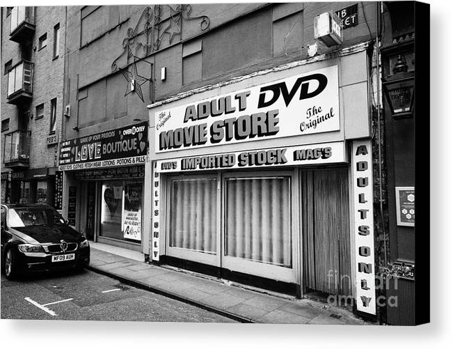 Northern Canvas Print featuring the photograph adult dvd store and sex shop Northern quarter Manchester uk by Joe Fox