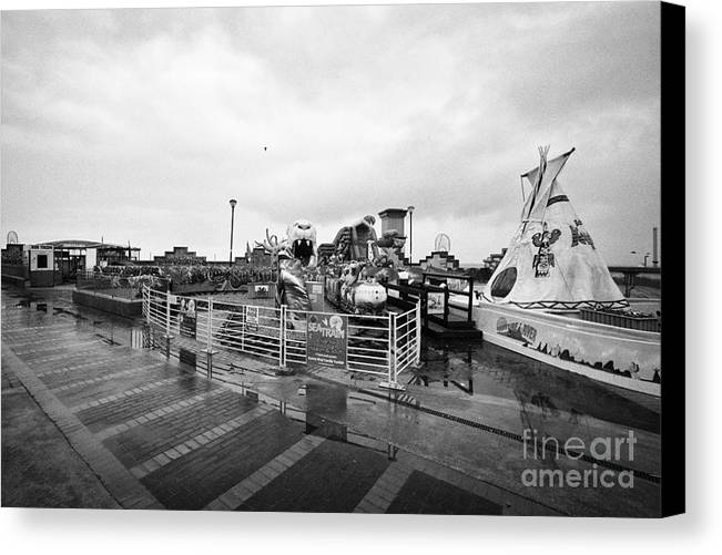 Empty Canvas Print featuring the photograph Empty Outdoor Amusement Park On A Cold Wet British Summer Day North Wales Uk by Joe Fox