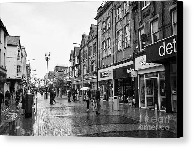 High Canvas Print featuring the photograph High Street Rhyl On A Wet Summers Day North Wales Uk by Joe Fox