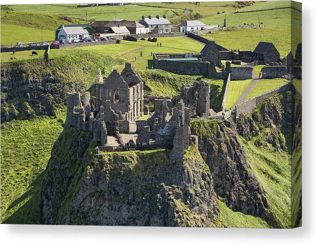 Britain Canvas Print featuring the photograph Dunluce Castle, Bushmills by Colin Bailie