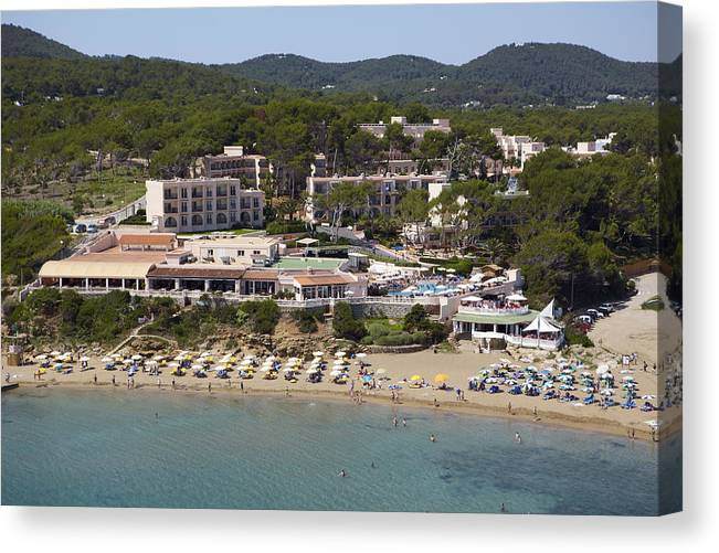 Baleares Canvas Print featuring the photograph Es Figueral Beach And The Invisa Hotels by Xavier Durán