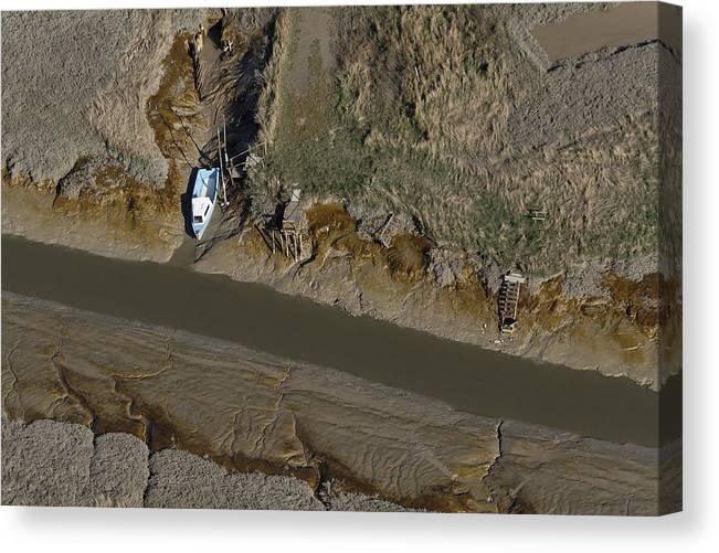 Europe Canvas Print featuring the photograph Boat In Marais Poitevin, Marans by Laurent Salomon