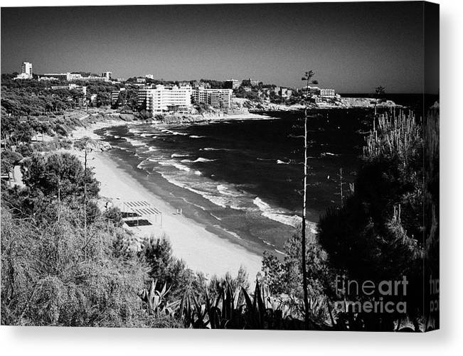 Salou Canvas Print featuring the photograph Playa Llarga And Cap De Salou Waterfront Properties On The Costa Dorada Catalonia Spain by Joe Fox