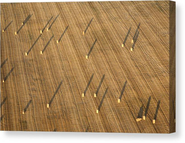 Chenevelles Canvas Print featuring the photograph Straw Bales, Chenevelles by Laurent Salomon