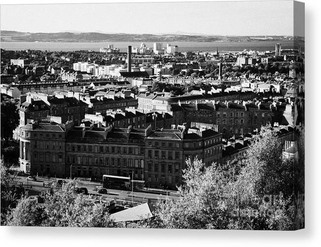 Calton Canvas Print featuring the photograph View Of Edinburgh New Town Skyline Towards The Docks At Leith And Firth Of Forth From Calton Hill Ed by Joe Fox