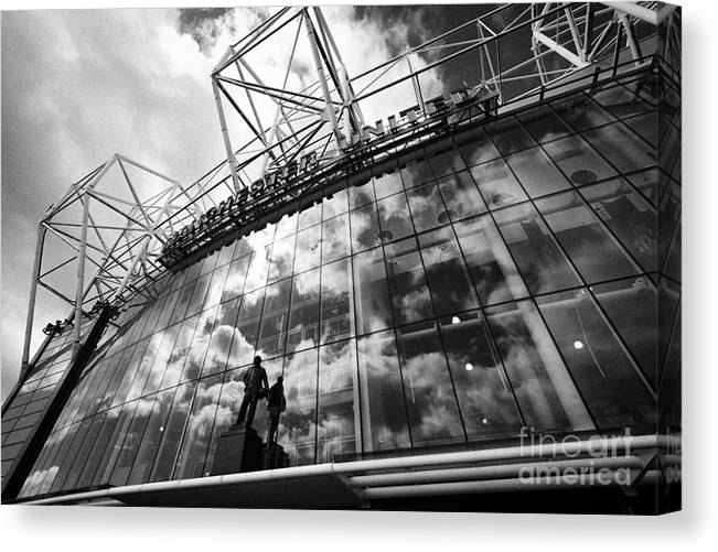 Manchester Canvas Print featuring the photograph Manchester United Old Trafford Stadium Uk by Joe Fox