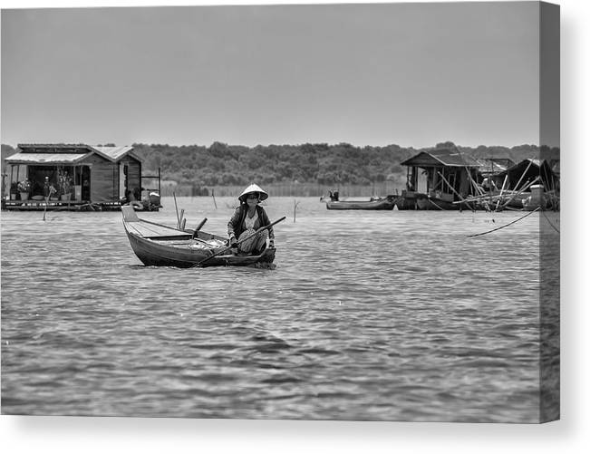 Cambodian Woman In A Boat Canvas Print featuring the photograph Cambodian Woman In A Boat by Georgia Fowler