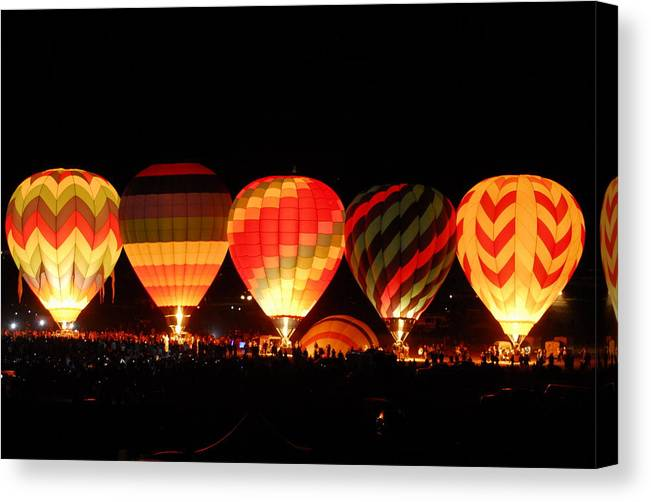 Balloon Canvas Print featuring the photograph Mass Balloon Glow by Owen Ashurst