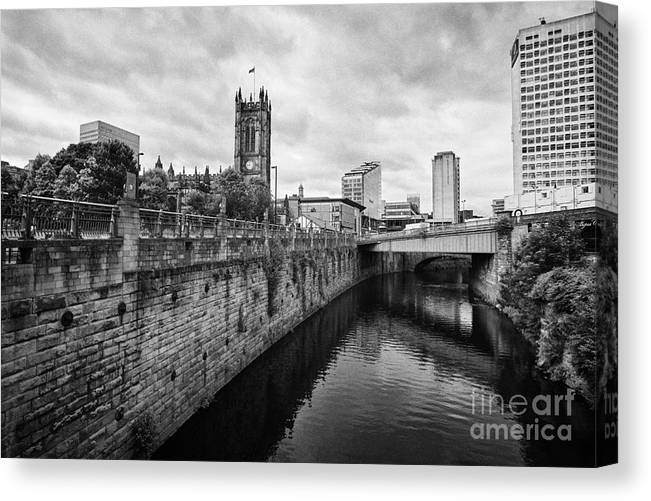 River Canvas Print featuring the photograph river irwell flowing between manchester on the left and salford on the right Manchester uk by Joe Fox