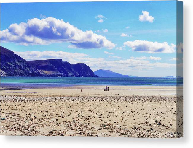 Achill Canvas Print featuring the photograph Wandering On The Beach Under The Clouds by Paul Mc Namara