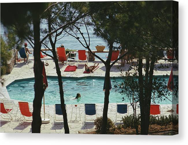 People Canvas Print featuring the photograph Hotel Il Pellicano by Slim Aarons