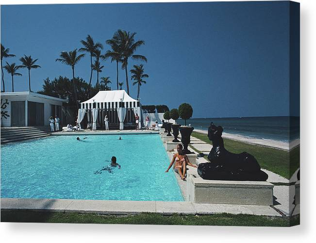 1980-1989 Canvas Print featuring the photograph Molly Wilmots Pool by Slim Aarons