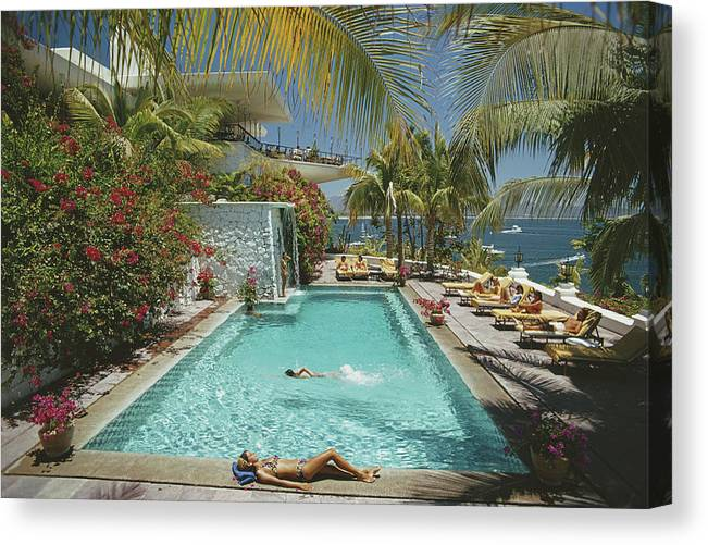 People Canvas Print featuring the photograph Pool At Las Hadas by Slim Aarons