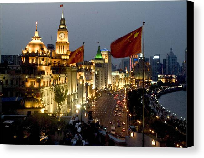 Shanghai Bund Canvas Print featuring the photograph Shanghai Bund At Night by Charles Ridgway
