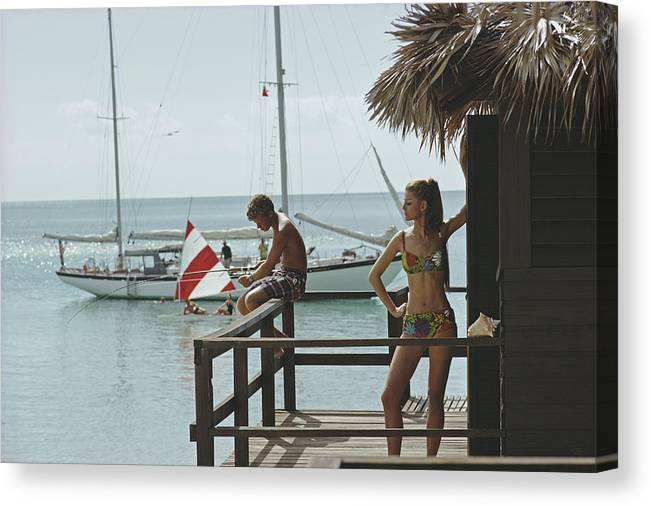 Beach Hut Canvas Print featuring the photograph Fishing On Honeymoon Porch by Slim Aarons