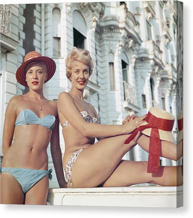 Straw Hat Canvas Print featuring the photograph Cannes Cannes Girls by Slim Aarons