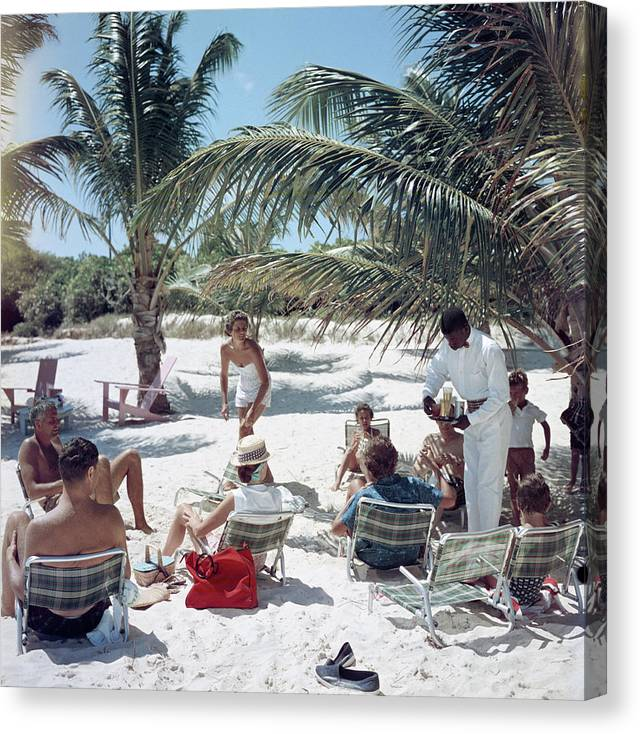 Afro-caribbean Ethnicity Canvas Print featuring the photograph Drinks On The Beach by Slim Aarons