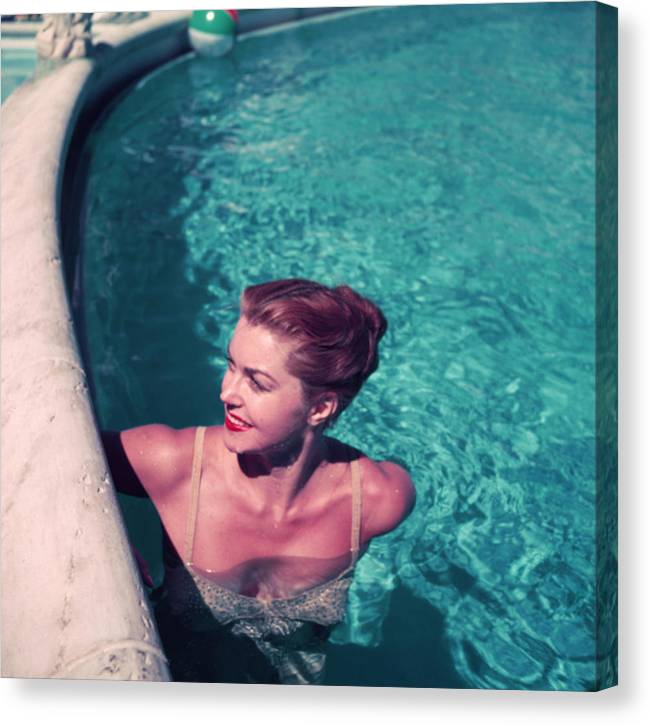 People Canvas Print featuring the photograph Esther Williams In Pool by Slim Aarons