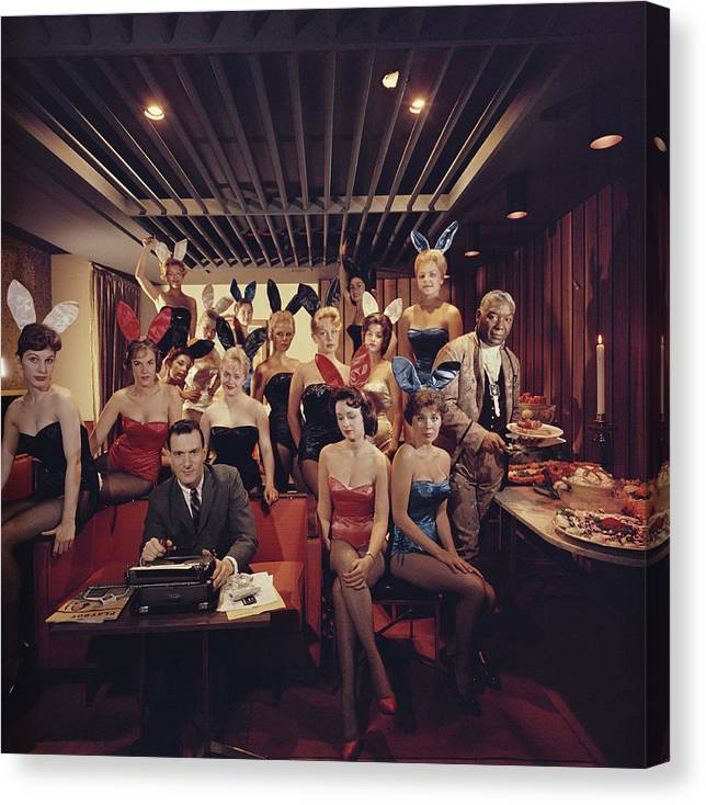 Hugh Hefner Canvas Print featuring the photograph Mans Work by Slim Aarons