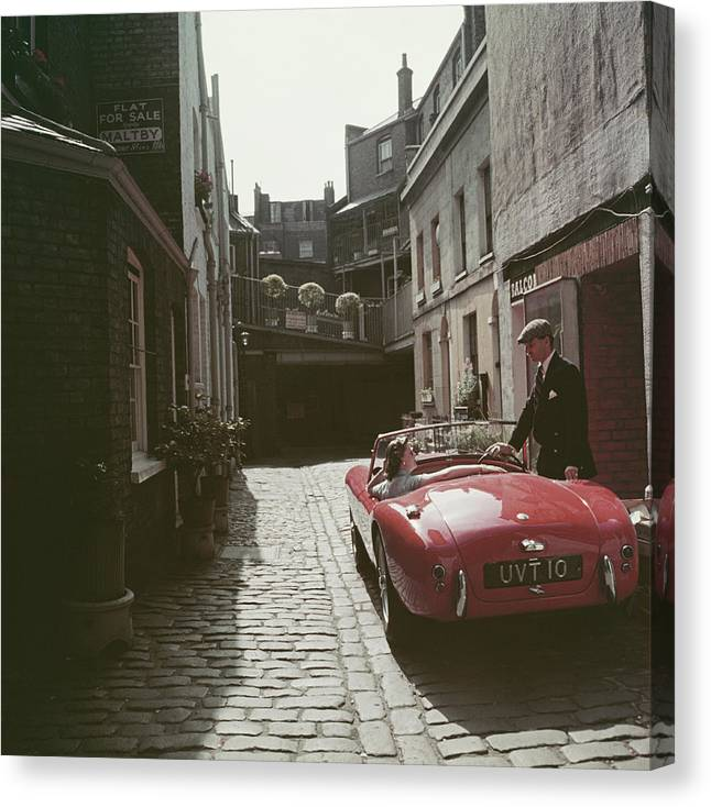 People Canvas Print featuring the photograph Sports Car Couple by Slim Aarons