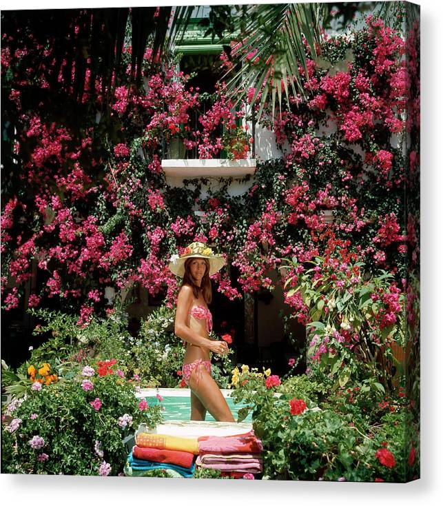 Straw Hat Canvas Print featuring the photograph Valerie Cates by Slim Aarons