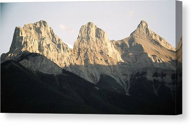 Rocky Mountains Canvas Print featuring the photograph The Three Sisters of the Rockies by Tiffany Vest