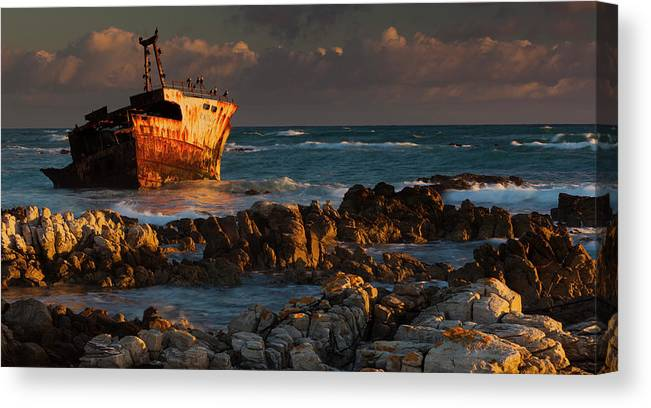 Non-urban Scene Canvas Print featuring the photograph A Rusting Wreck, An Abandoned Ship Off by Mint Images - Art Wolfe