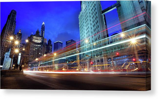 Chicago River Canvas Print featuring the photograph Bus Trails At Blue Hour by Chris Smith Www.outofchicago.com