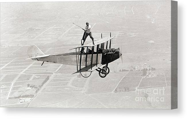 People Canvas Print featuring the photograph Daredevil Al Wilson Golfing On Biplane by Bettmann