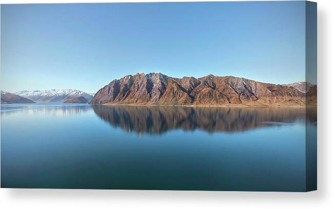 Scenics Canvas Print featuring the photograph Mountain Reflected On Lake Hawea by Verity E. Milligan
