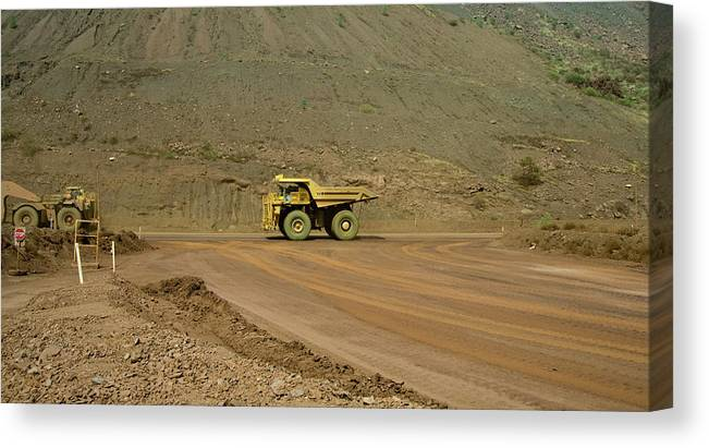 Southern Hemisphere Canvas Print featuring the photograph Tom Price Earthmover by Samvaltenbergs