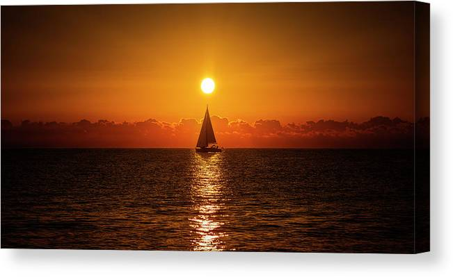 Life Canvas Print featuring the photograph A Sailboat Sailing The Sea by Vicen Photography