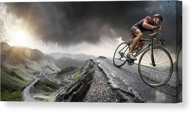 Sports Helmet Canvas Print featuring the photograph Cyclist Climbs To The Top by Peepo