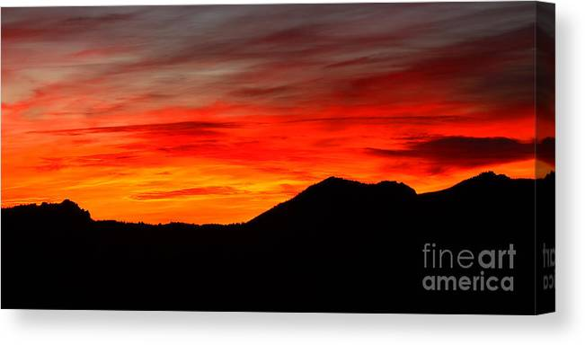 Sunrise Canvas Print featuring the photograph Sunrise Against Mountain Skyline by Max Allen