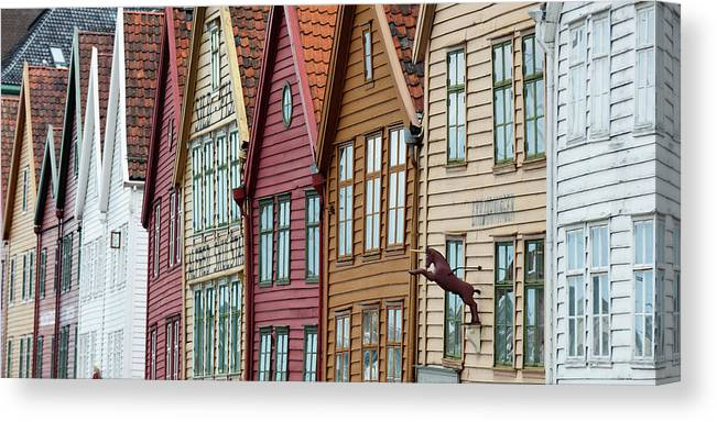 Panoramic Canvas Print featuring the photograph Colourful Houses In A Row by Keith Levit / Design Pics