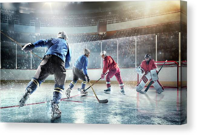 Sports Helmet Canvas Print featuring the photograph Ice Hockey Players In Action by Dmytro Aksonov