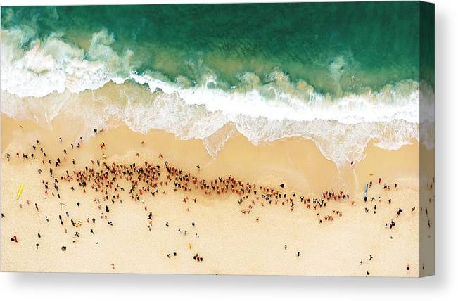 Water's Edge Canvas Print featuring the photograph Swimmers Waiting For An Ocean Race To by Tommy Clarke