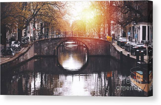 Jordaan Canvas Print featuring the photograph Amsterdam Cityscape With Canal by Serts