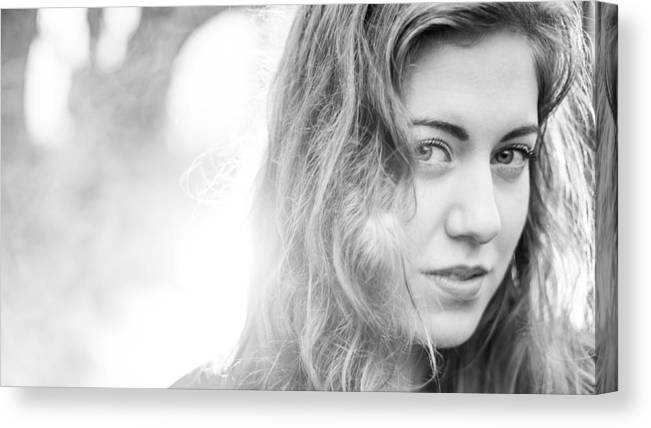 People Canvas Print featuring the photograph Beautiful young woman in the woods by Theasis