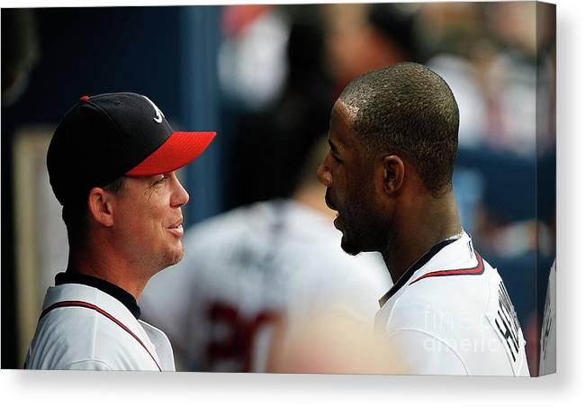 Atlanta Canvas Print featuring the photograph Chipper Jones and Jason Heyward by Kevin C. Cox