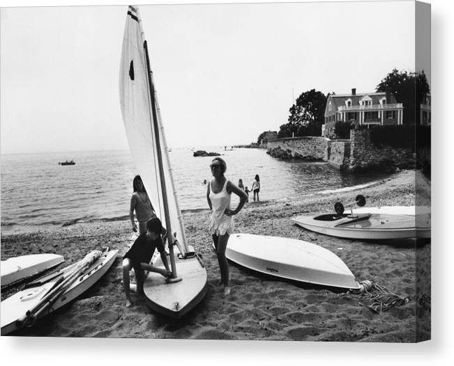 Child Canvas Print featuring the photograph Sailboat by Slim Aarons