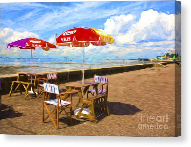Southend On Sea Canvas Print featuring the photograph Chairs and umbrellas at Southend on Sea by Sheila Smart Fine Art Photography