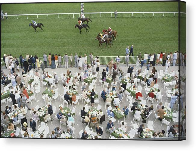 Horse Canvas Print featuring the photograph Racing At Baden-baden by Slim Aarons