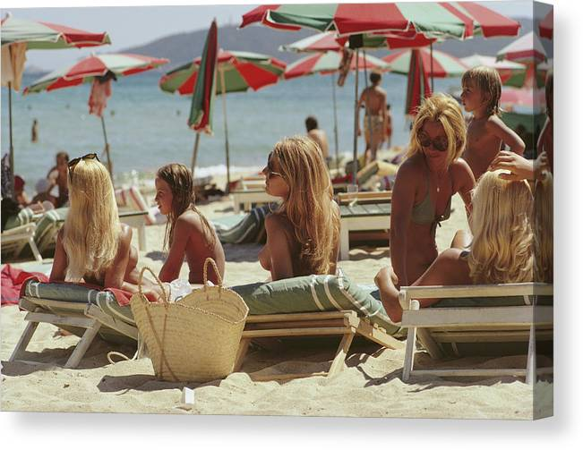 Child Canvas Print featuring the photograph Saint-tropez Beach by Slim Aarons