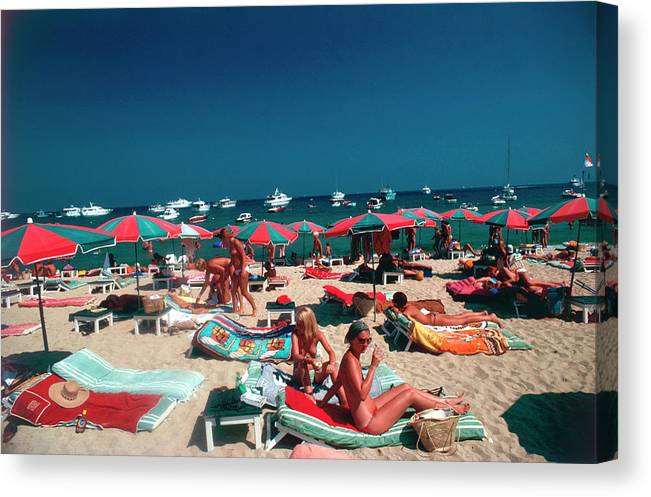 People Canvas Print featuring the photograph Beach At St. Tropez by Slim Aarons