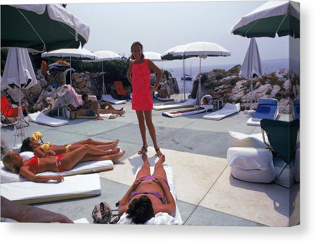People Canvas Print featuring the photograph Eden Roc Beach Club by Slim Aarons