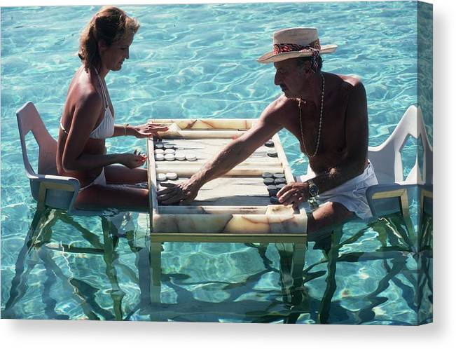 Straw Hat Canvas Print featuring the photograph Keep Your Cool by Slim Aarons