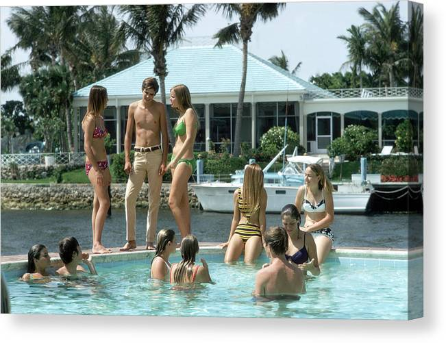 Young Men Canvas Print featuring the photograph Phil Richards Pool by Slim Aarons